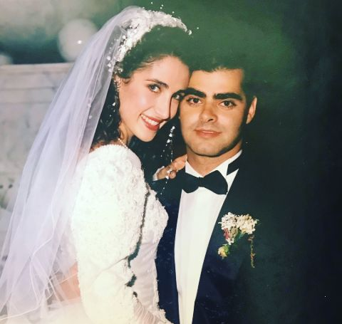 Peter Constantinides with his Melina Kanakaredes in their wedding.