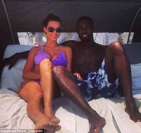 Rodney Stuckey and wife Cassandra Ferguson chilling at a hotel.