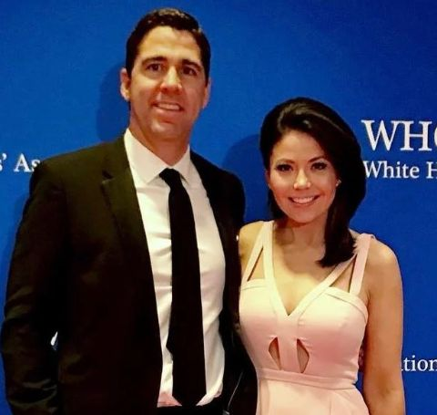 Angie Goff in white dress with husband Robert Ellis.