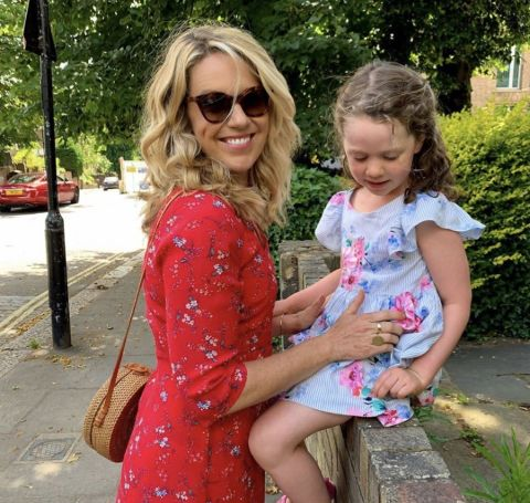 Jessica St.Clair in a red outfit with daughter