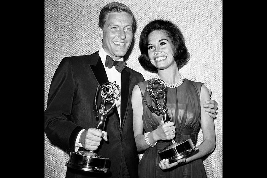 Dick Van Dyke and Mary Tyler Moore with their Emmys at the 16th Emmy Awards.