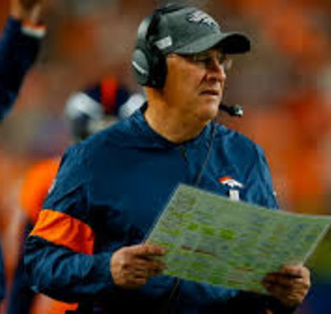 Vic Fangio in a blue t-shirt of Denver Broncos.