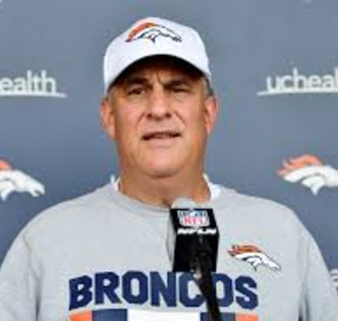 Vic Fangio in Denver Broncos' t-shirt gives an interview.