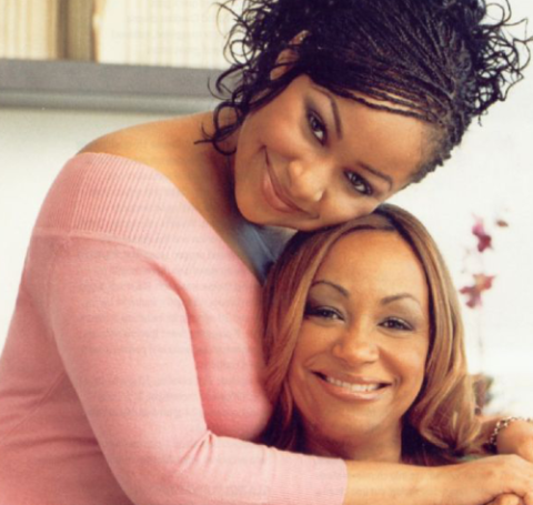 Lydia Gaulden poses besides her daughter Raven-Symone in her home.