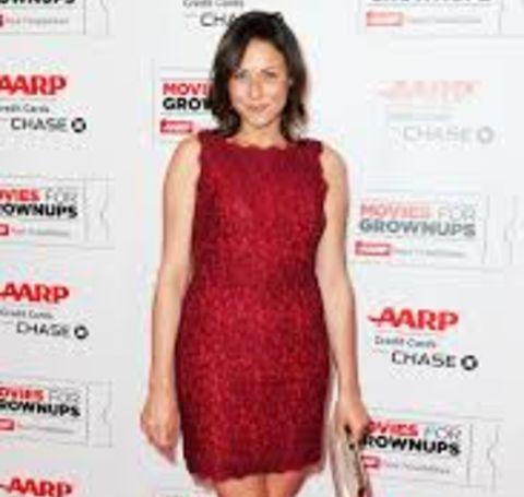 Vanessa Cloke in a red dress poses for a picture.
