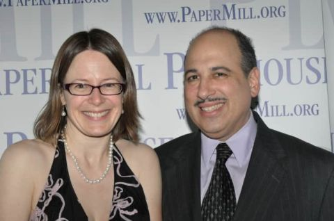 Michael Kostroff giving a pose along with his wife, Jennifer Sheneman.