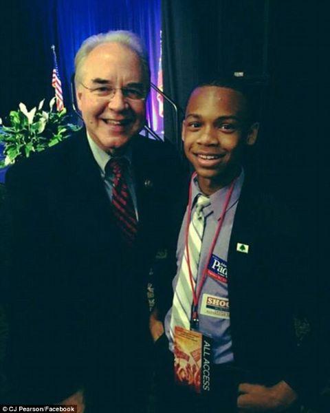 CJ Pearson giving pose with a politician.