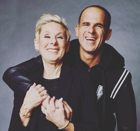 Roberto Raffel and her husband Marcus Lemonis in black pose for a photoshoot.