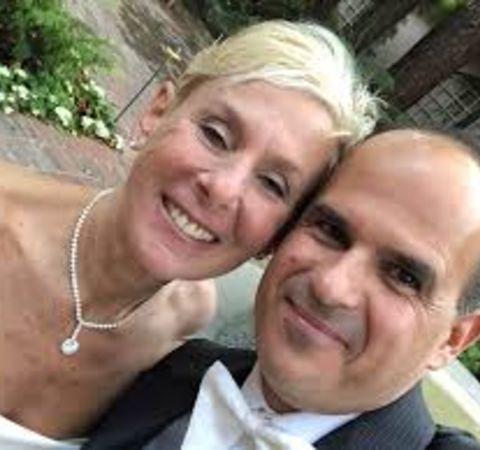 Roberta Raffel  in her wedding gown clicks a selfie with husband Marcus Lemonis.