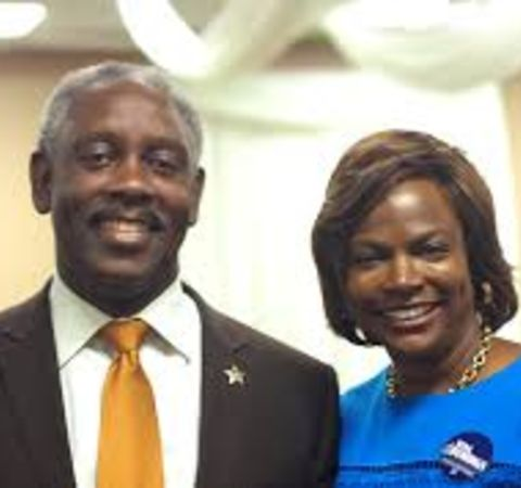 Val Demings with her husband Jerry Demings pose for a picture.