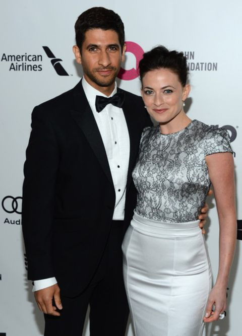 Raza Jaffrey giving a pose along with his wife, Lara Pulver in an event.