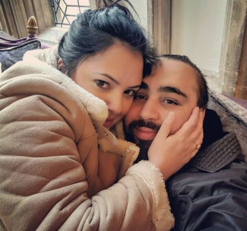 Asim Chaudhry  in a black jacket poses with girlfriend.