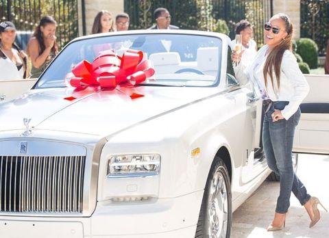 Marjorie Elaine Harvey giving a pose with Rolls-Royce Phantom Drophead Coupe car.