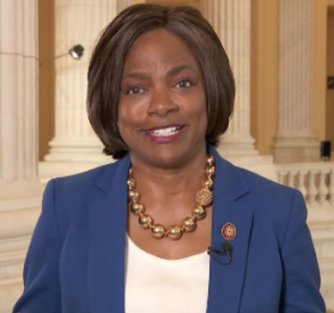 Val Demings in a blue coat poses for a picture.