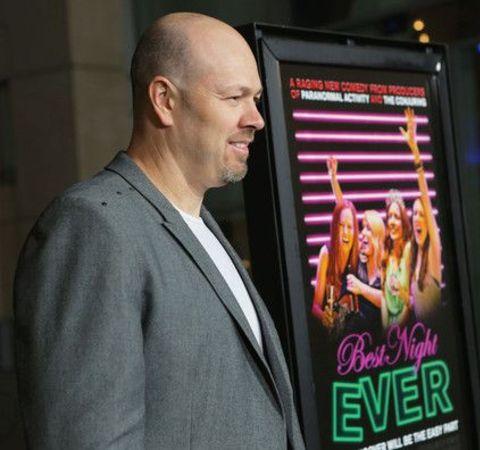Herschel Faber poses alongside poster of Best Night Ever.