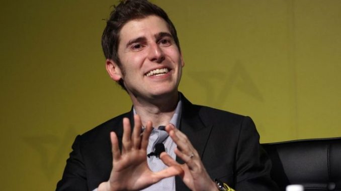 Eduardo Saverin in a black suit caught on camera during a seminar.