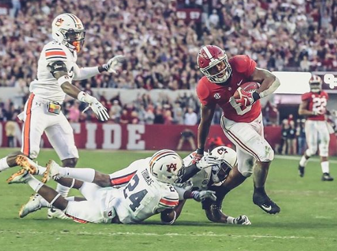 Josh Jacobs With Ball And Fighting Against The Opponent