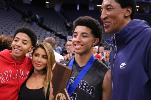 Preston Pippen in a red t-shirt alongside his family.