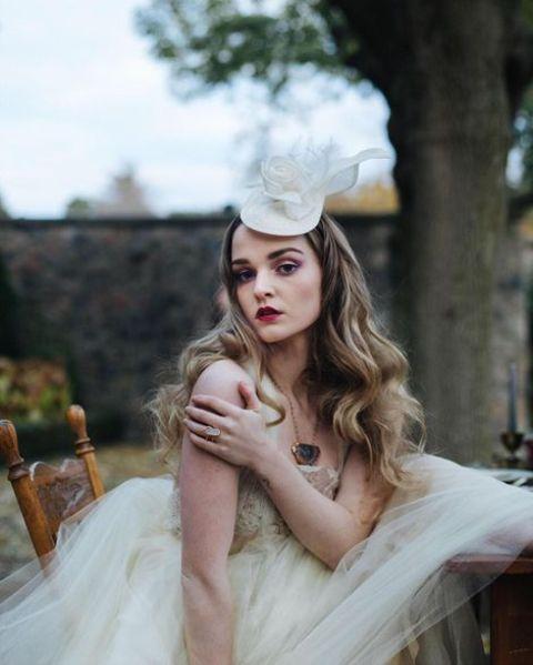 Hallea Jones giving a pose in a wedding dress.