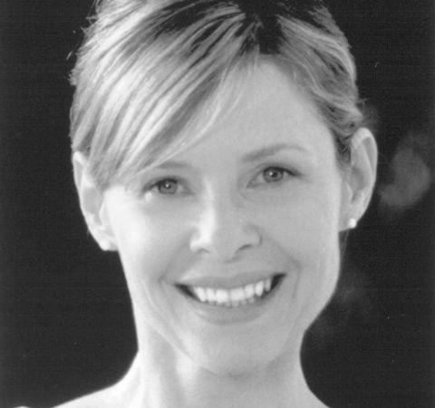 Actress Kate Capshaw smiles at the camera.