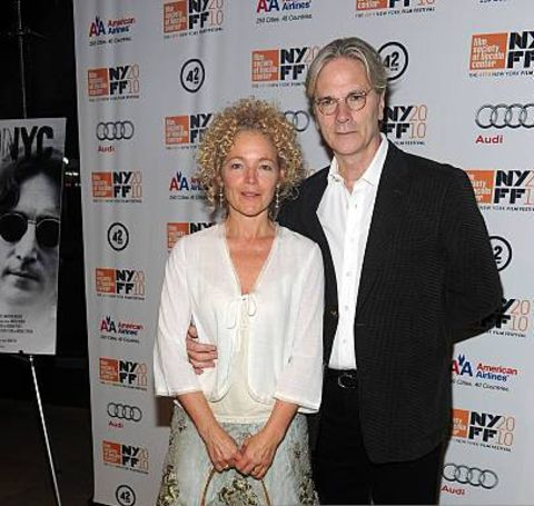 Kenneth Bowser giving a pose along with his wife, Amy Irving.