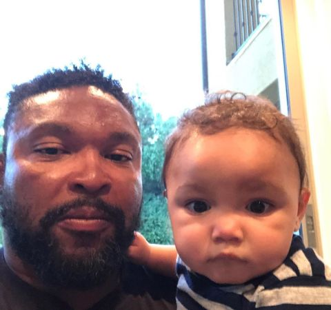 Marlon Byrd poses with his son for a picture.
