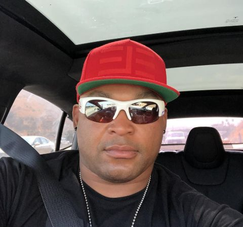 Marlon Byrd in a red cap poses for a picture in car.