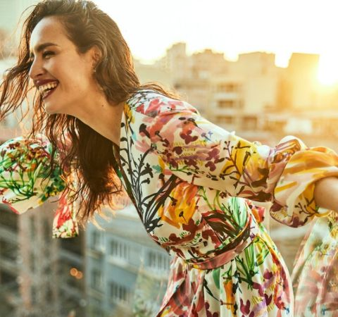 Fernanda Urrejola in a colorful dress poses for a picture.