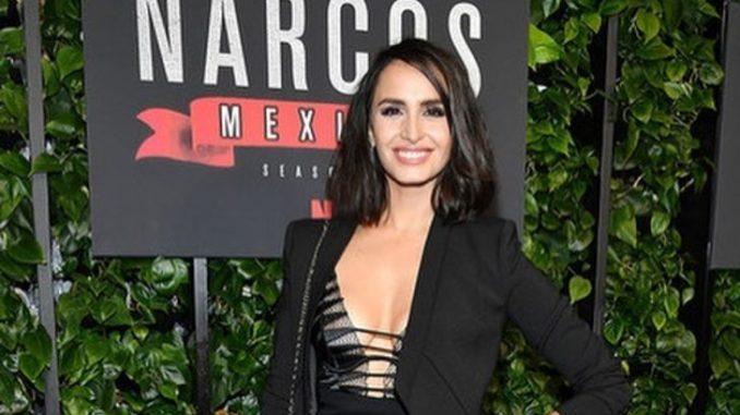 Fernanda Urrejola in a black dress poses at the premiere of Netflix season 2.