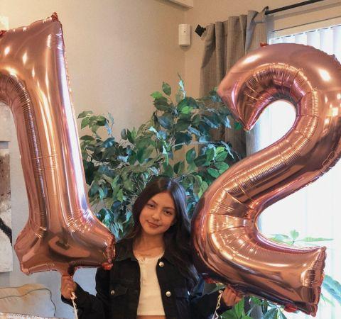 Elle Paris Legaspi in a black jacket celebrates her 12th birthday.