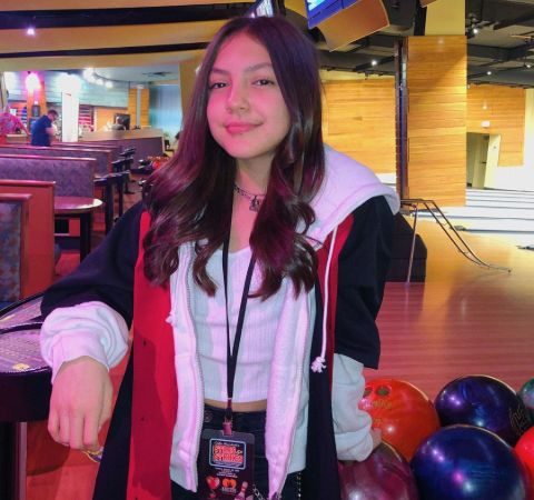 Elle Paris Legaspi in a red jacket poses for a picture.