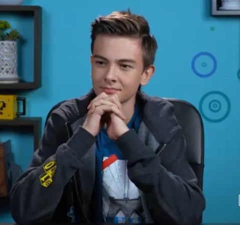 Jaxon React in a black jacket poses during reacting.