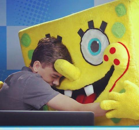 Jaxon React hugging  a sponge-bob doll.