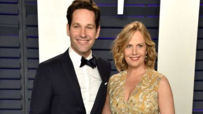 Julie Yaeger in a brown wife poses with husband Paul Rudd. Source: Good housekeeping