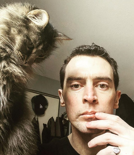 Nicholas Tucci With A Cat
