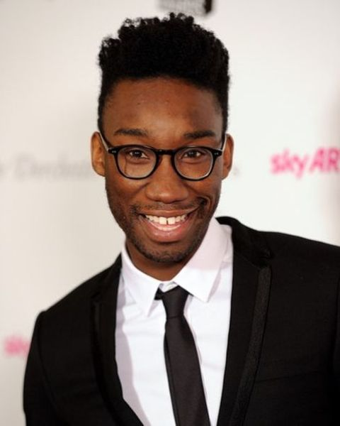 Nathan Stewart Jarrett giving a pose in an event.