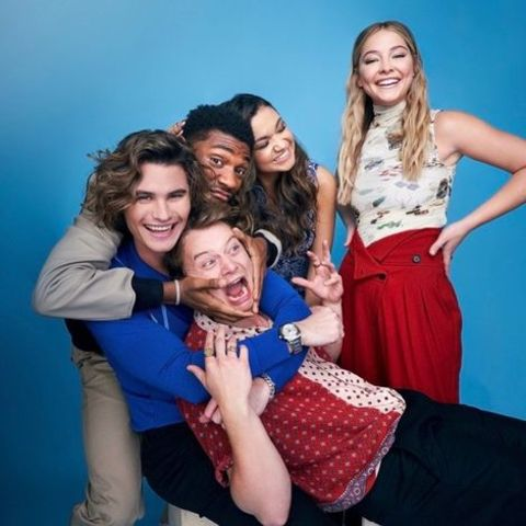 Jonathan Daviss giving pose along with his co-stars from Outer Banks.