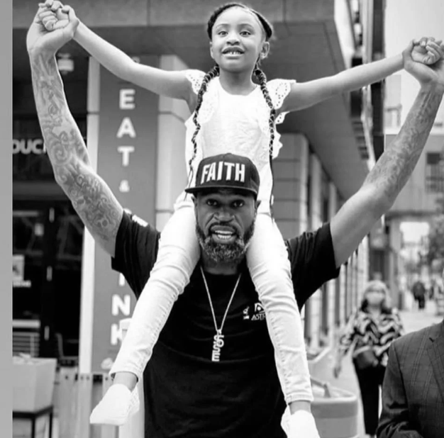 Stephen Jackson with George Floyd's daughter, 6-year-old Gianna Floyd, at protests