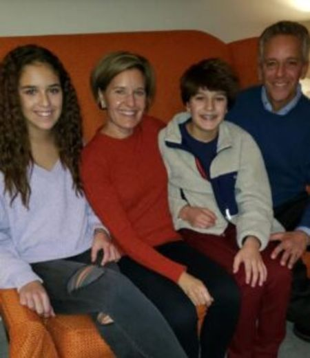 Polly Brennaman poses a picture with her family.