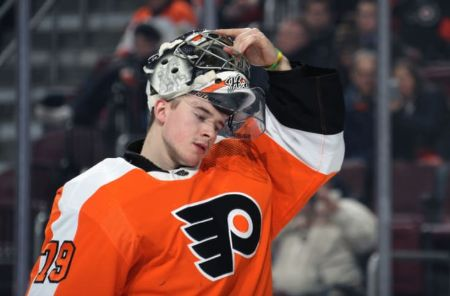 A Snippet of Carter Hart in his suit