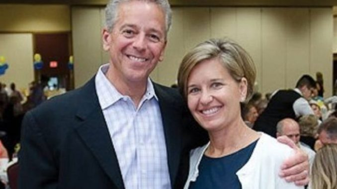 Polly Brennaman and Thom Brennaman pose for a picture.