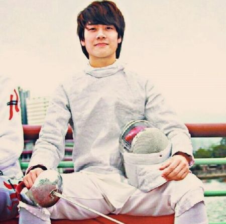 Jackson Wang at an early age in fencing dress