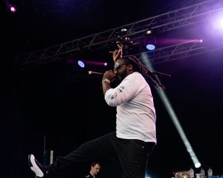 Kenny Allstar performing with energy