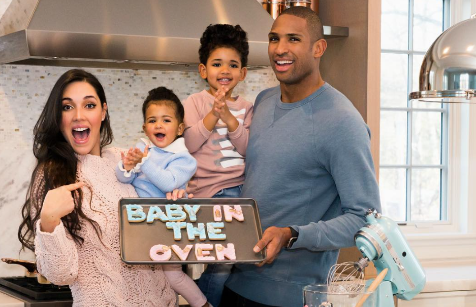 Al Horford with his wife, Amelia Vega and their kids