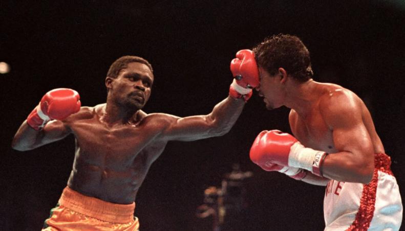 Azumah Nelson fighting against Juan LaPorte