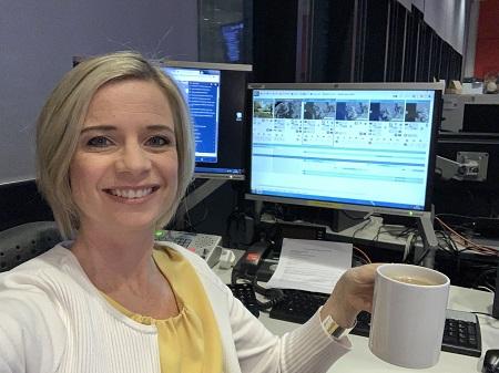 Sarah enjoying coffee at the office