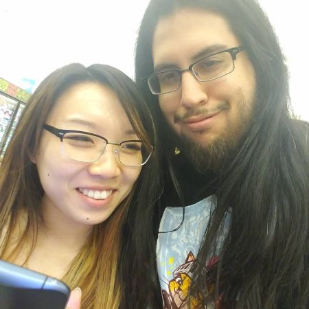 Lisha Wei and her Husband taking a picture together