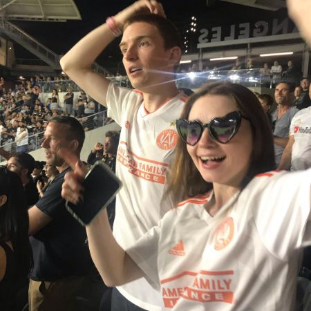 Jessica Barden and Bill Milner at a Football match