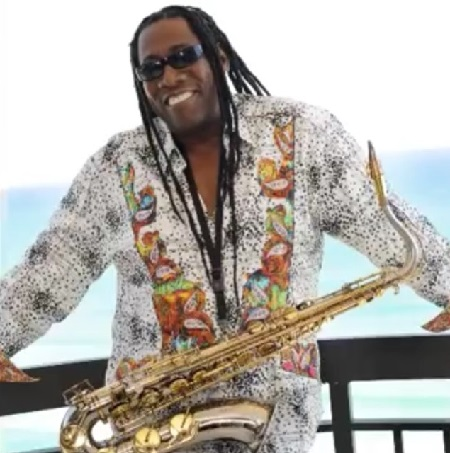 The late legend Clarence Clemons smiling at the camera