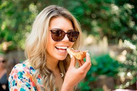 Ginger Luckey smiling as she enjoys her food
